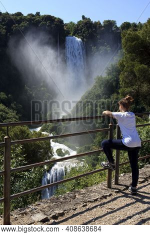 Terni (tr), Italy - May 10, 2016: A Girl Looks The Famous Marmore Waterfall, Terni, Umbria, Italy