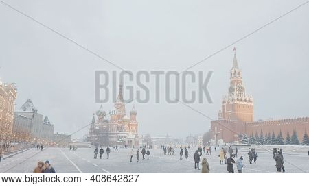 Moscow, Russia - December, 2020: Red Square With People Walking On Cloudy Winter Day. Action. Lively