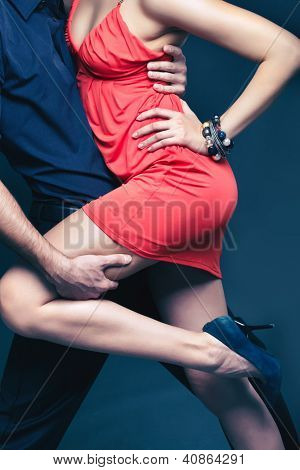 Vertical shot of a dancing couple captured in a dynamic motion