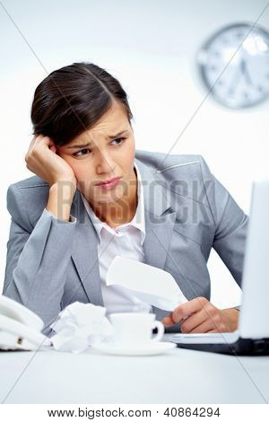 Vertical shot of an office lady being depressed with the current business situation