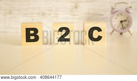 The Word B2c Consists Of Wooden Cubes With Letters, Top View On A Light Background. Work Space.