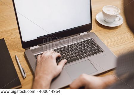 Man Working Remotely On Laptop. Businessman Working From Home During Pandemic