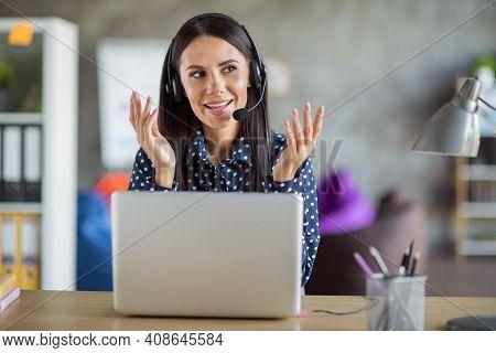 Photo Of Brunette Beautiful Serious Woman Speak Talk Client Help Line Sit Desk Laptop In Office Indo