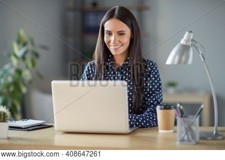 Photo Of Young Attractive Happy Positive Smiling Cheerful Good Mood Businesswoman Working In Laptop