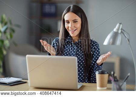 Photo Of Positive Business Woman Talk Webcamera Client Sit Desk Work In Office Workplace Indoors Wor