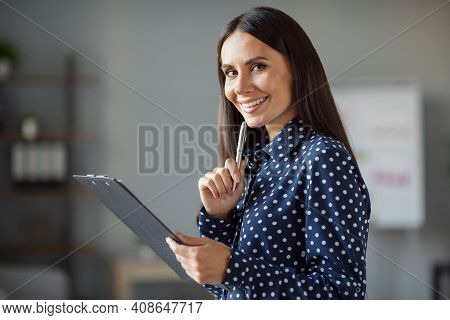 Profile Side Photo Of Cheerful Happy Young Business Woman New Idea Hold Clipboard Make Plan In Offic