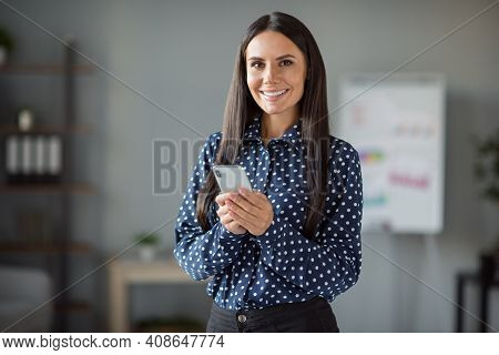 Photo Of Happy Brunette Business Woman Hold Phone Wear Formalwear Good Mood In Office Indoors Workst