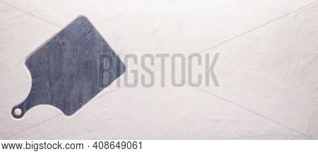 Flour food powder and trace of pizza cutting board as bakery concept for homemade bread baking on table. Recipe top view at stone background texture with copy space, flat lay concept
