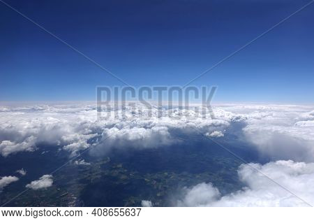 Beautiful Sky Landscape With View From The Aircraft Above Dense White Clouds High In The Stratospher