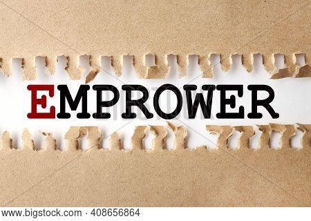 Empower. Text On White Paper Over Torn Paper Background.