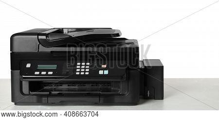 New Modern Multifunction Printer On Light Table