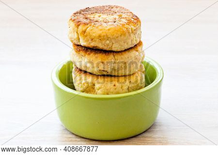 Homemade Cottage Cheese Pancakes Syrniki Stack On Round Green Bowl On White Rustic Natural Wooden Ta