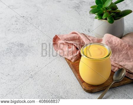 Yellow Mango Lassi On Gray Background. Indian Mango Yogurt Drink With Copy Space Left.
