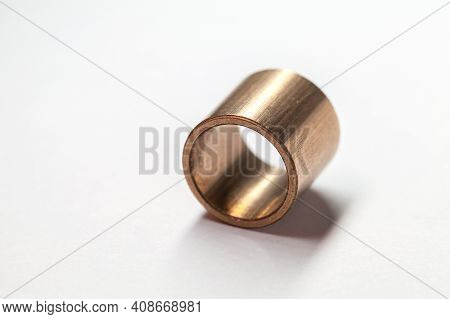 Sleeve Bronze Bearing Lays On A White Background, Close-up Photo With Selective Focus