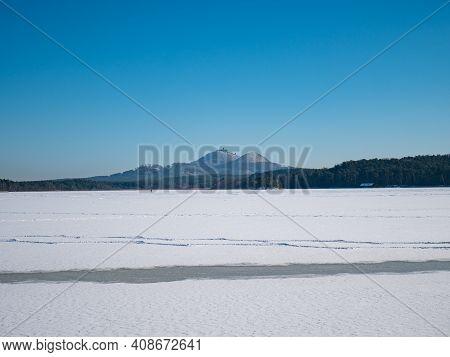 Bezdez Castle On Bezdez Hill Above Frozen Machovo Lake. Blue Winter Landscape, Freeze Forest With Sn