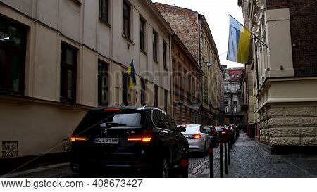 Traffic On One Way Narrow Street Ferenc Liszt In European Town Lviv Of Ukraine. Red Car Back Lights