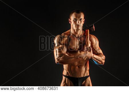 Portrait Of Serious Muscular Topless Man With Sledgehammer