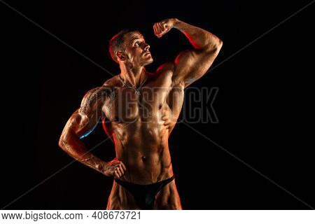Shirtless Man With Muscular Topless Body Holding Arm Up. Isolated.