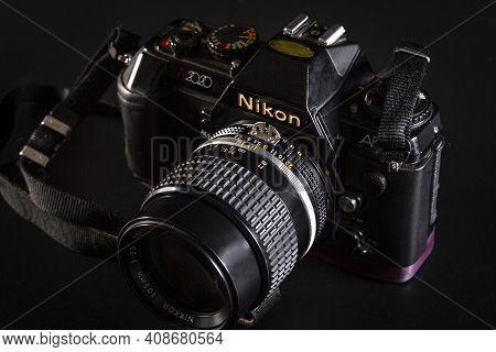 Israel. Rishon Lezion 02.06.2021. Film Camera Nikon N2020 With A Nikkor 105mm 1: 2.5 Lens On A Black