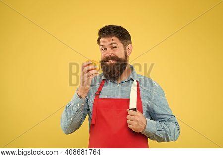 Chef Prepares Meal. Bearded Man Prepare Tomato. Fresh Salad Recipe. Mature Man Hold Knife And Vegeta