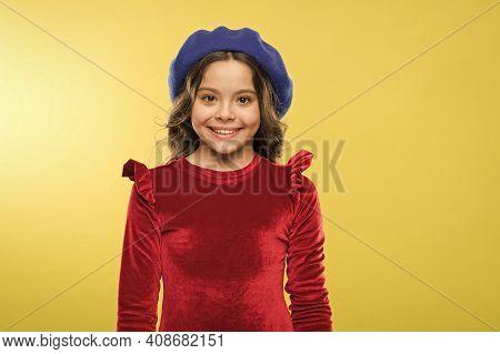 Happy Childhood. Smiling Stylish Teen Girl In French Beret. Parisian Kid Wear Red Dress. Elegant Loo