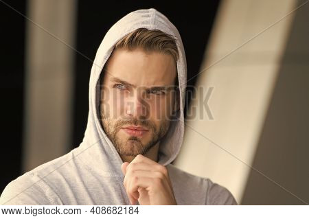 His Beard Is Unshaven. Unshaven Man In Hood Outdoors. Handsome Guy With Unshaven Face. Bachelor Wear