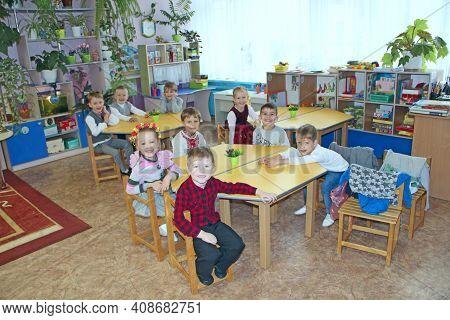 Chernihiv - Ukraine. 28 December 2019:  Children Sitting At The Tables In Kindergarten. Happy Kids.