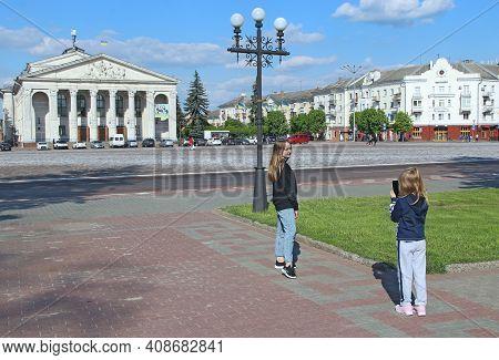 Chernihiv - Ukraine. 24 April 2018: Girls Take Pictures On Central Area Of Chernihiv. Happy Children