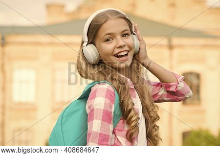 Child Headphones Listen Music. Audio Book Concept. Studying Audio Lessons. Listen Music While Walkin