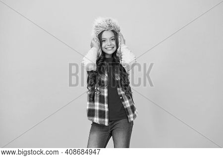 Add Some Personality To Cold Weather Wardrobe. Happy Child Wear Faux Fur Hat. Little Girl Smile In H