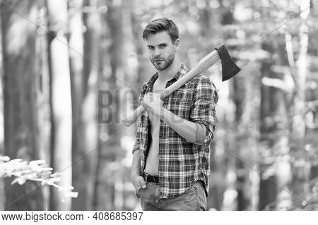 Serious About. Sexy Guy Wear Unbuttoned Shirt In Forest. Male Power And Energy. Firewood At The Camp