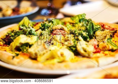 Defocus Close Up Caesar Pizza With Chicken And Iceberg Salad On Restaurant, Cafe, Pizza Time. Appeti