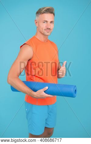 Meditations Designed To Help You Find Your Joy. Man Practicing Yoga At Home. Handsome Sportsman With