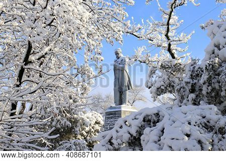Winter In Ukraine. A Large Monument To Famous Ukrainian Poet Shevchenko Among The Picturesque Landsc