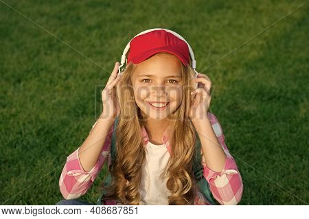 Listen Music While Relaxing Outdoors. Girl Headphones Listening Music. Educational Podcast. Enjoy Ev