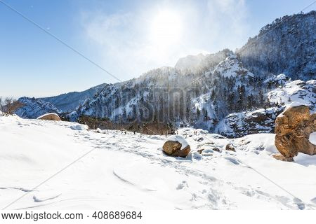 Snowstorm At The Top Of The Mountain. Snowy Plateau Of A Low Mountain During Heavy Snowfall