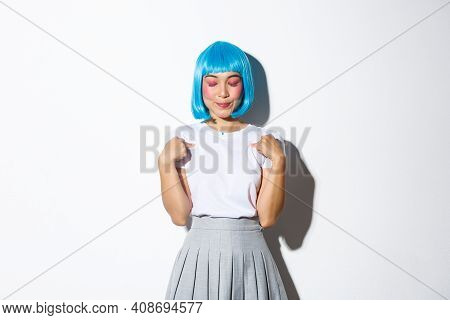 Portrait Of Dreamy Smiling Asian Girl Pointing At Herself, Close Eyes And Encourage Herself, Making
