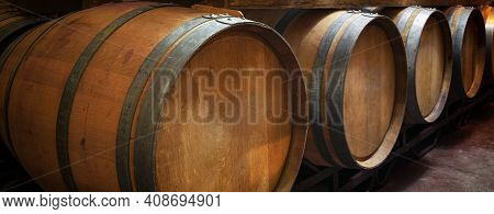 Wooden Wine Barrels In Wine Cellar. Concept Product Banner. High Quality Photo