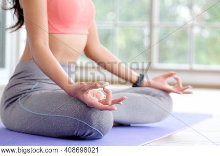 Close Up Of Woman Practice Yoga Meditation Exercise At Home, Young Female Sitting On Mat For Relaxed