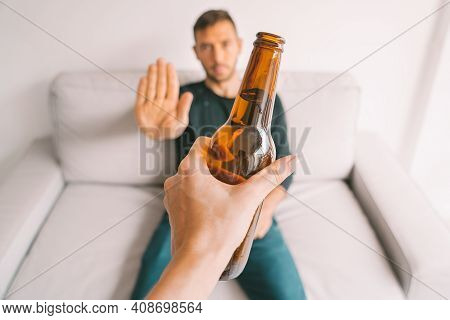 No Alcohol. Young Man Refuses To Drink Beer. Stop Drinking. Say No To Alcoholism. Treatment Of Alcoh