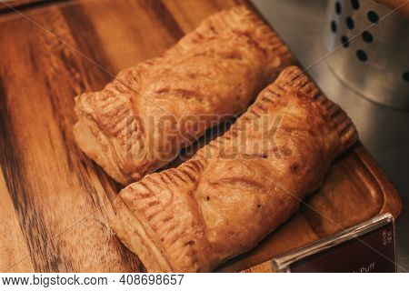 Puff Pastry With Toppings. Puffs With Cheese On A Wooden Tray. Pastries And Bakery, Top View.