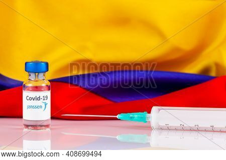 Bogota, Colombia - February 2021. Janssen Covid Vaccine Vial And Colombian Flag. Vaccination Concept
