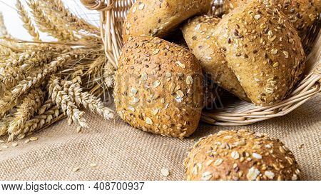 Rustic Bread. Fresh Loaf Of Rustic Traditional Bread With Wheat Grain Ear Or Spike Plant On Linen Te