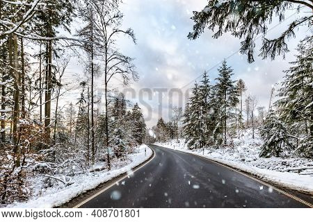 Snowy Winter Street Sourround Wood In Germany