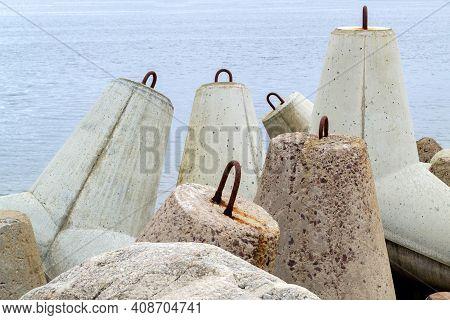 Ventspils Pier, Latvia. Tetrapods In Baltic Sea Water. Breakwater Concrete Dam Venta River. Pier Pro