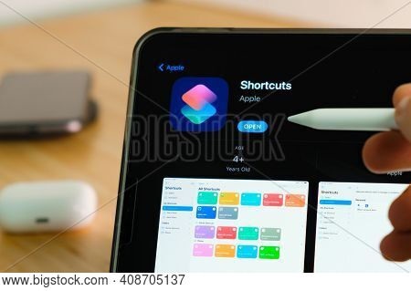 Shortcuts Logo Shown By Apple Pencil On The Ipad Pro Tablet Screen. Man Using Application On The Tab