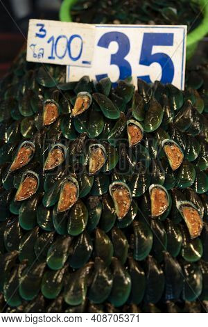 Pile Of Green Shells And Clams For Sale In Fresh Food Market In Pak Nam, Bangkok, Thailand.