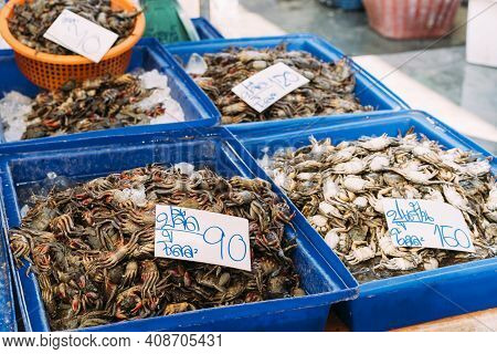 Small Crabs Piled In Blue Bins For Sale At Wet Market In Bangkok, Thailand.