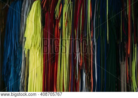 Colorful Shoelaces Hanging Up And Organized By Color, Close-up.