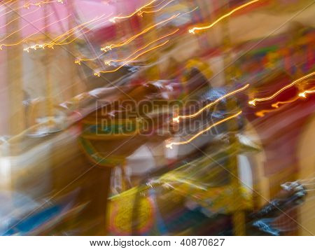 Carousel Horses In A Merry Go Round With Colorful Motion Blur